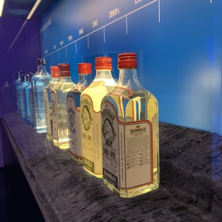Display of bottles design from the history of Bombay Sapphire