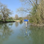 Channel sign reflected in the river